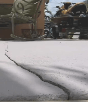 A concrete floor showing a big crack on the surface